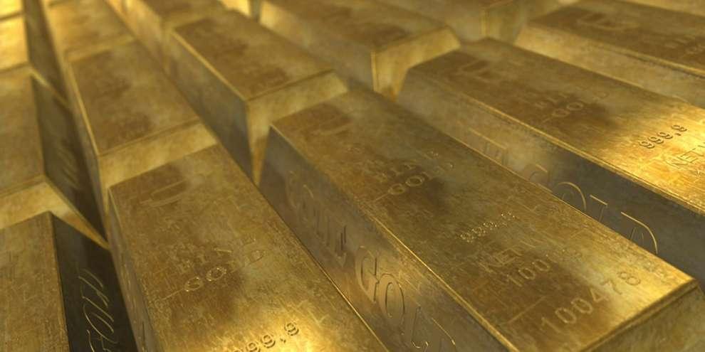 слитки золота золото